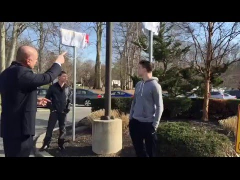 Paramus Mayor Richard LaBarbiera presents state wrestling champions Nick Suriano and Kyle Cochran with signs outside of Borough Hall on Tuesday afternoon.