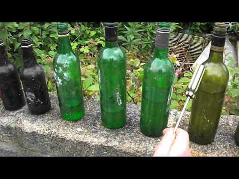 "Me playing ""ten-green-bottles"" literally using well eight green bottles on a wall at Wheal Busy .AVI"