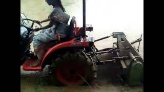 lady driving kubota tractor  kerala india
