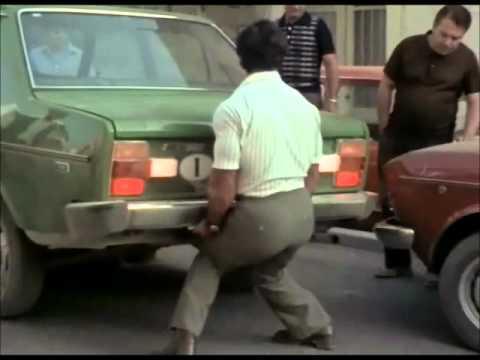Franco Columbu lifts a car in Pumping Iron