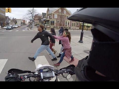 Rude Girl Shoves guy into Street