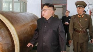 Images show Kim Jong Un with potential new missile plans