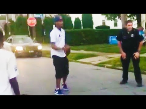 Cop 'Robs' During Street Football Game (VIDEO)
