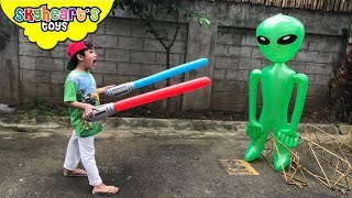 GREEN ALIEN vs. Toddler Part 2 | Skyheart lightsaber battle with inflatable alien toy attack battle