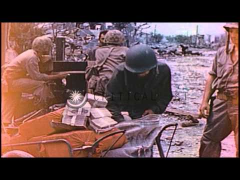 US Marines examine bundles of Japanese money in Saipan, Mariana Islands during Wo...HD Stock Footage