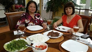 Two filipino aunties cooking beef tapa