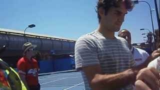 Federer signing autographs, up close, greeting the camera - Australian Open 2012