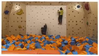 Rock Climbing Wall With Foam Pits Below