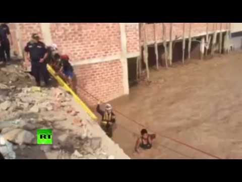 Rescue op underway in Peru after muddy flood leaves locals trapped