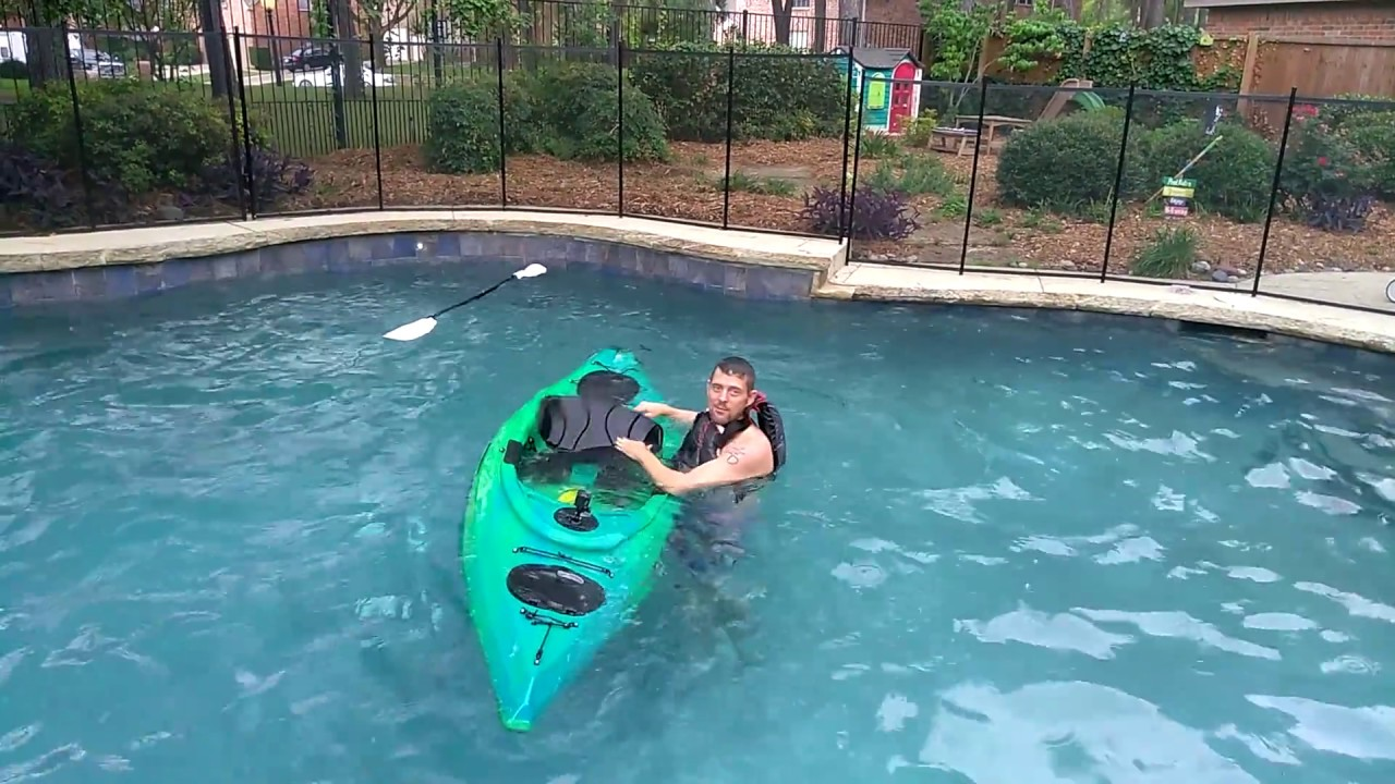 Trying to flip an Equinox Kayak the 10 4 sit-in