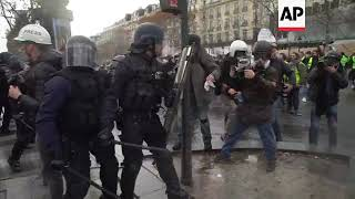 Police charge at protesters in Paris