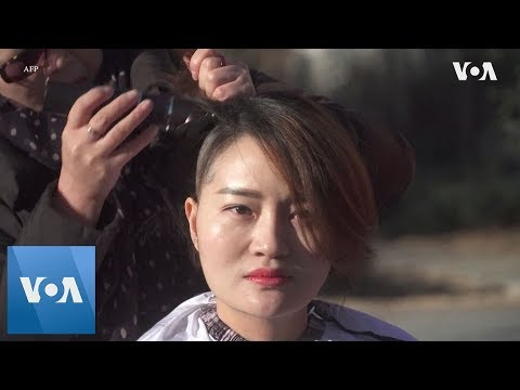 Wife of Detained China Activist Goes Bald
