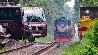 Train passing through a busy Rail Crossing/ Gate- Benapole Commuter of Bangladesh Railway thumbnail