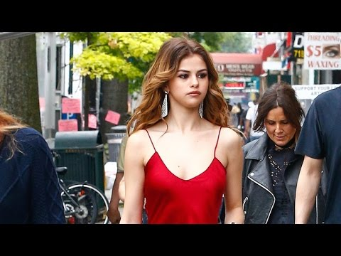 Selena Gomez Sports Two Sexy Red Dresses, Teases New Video 'Kill Em With Kindness'