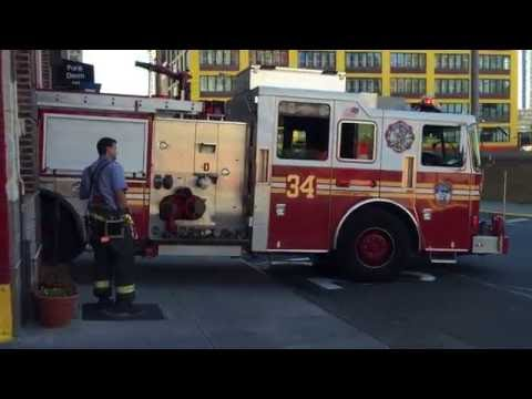 FDNY ENGINE 34 RETURNING TO QUARTERS ON WEST 38TH STREET IN MIDTOWN, MANHATTAN IN NEW YORK CITY.