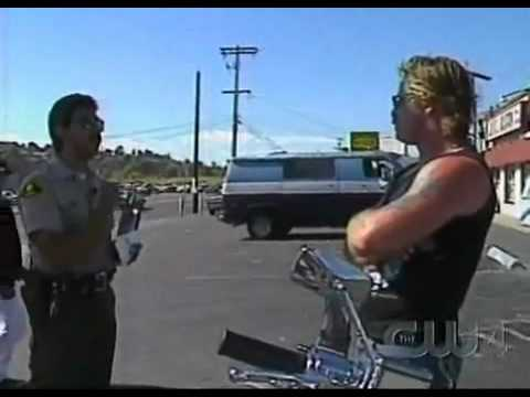 Cop pulls over Hell's Angel's  Biker