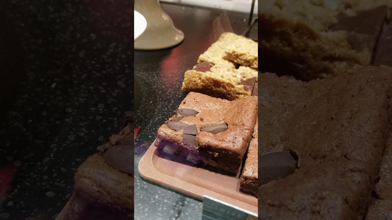 Starbucks Surrey BC flies feasting on pastries.