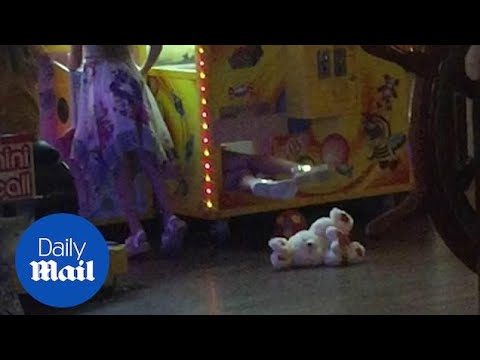 Little girl gets stuck inside claw machine when looking for a teddy