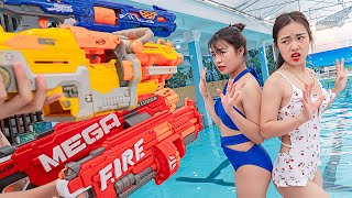 MAGIC DOOR OPENS TO DINOSAUR WORLD PRANK BATTLE NERF GUNS Fight With Criminals In Pool TL Nerf War