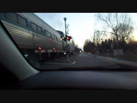 Amtrak Train Chasing Side By Side With Car And Train Horn Action