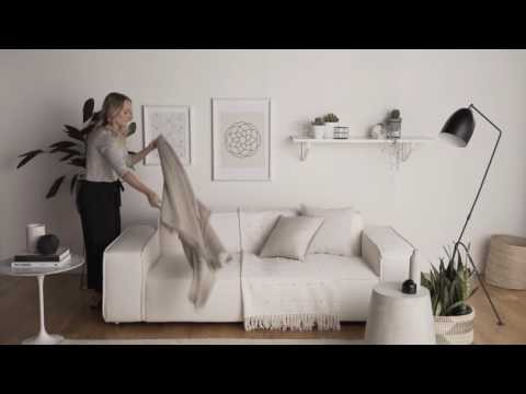 How To Style Your Living Space With Cushions And Throws