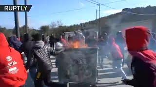 Refugees start fires after stabbing of 20yo man at Greek camp