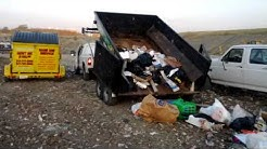 Junkguys trucks and trailers at the Grand Prairie Landfill 214-777-3095