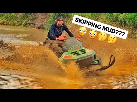 Snowmobile MUDDING! QUAD SINKS!!!