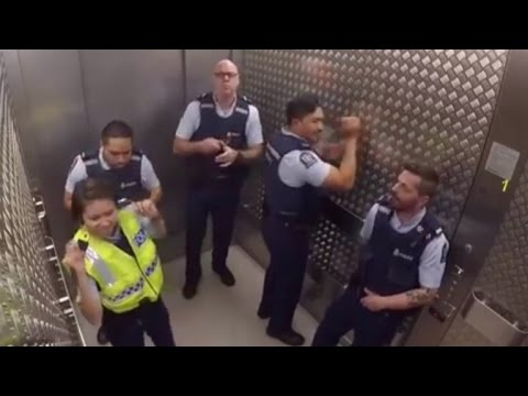 Watch Groovy Police Officers Break Out Into Silly Elevator Jam Session