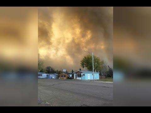 Sasketchwan wildfires, Burstall, open field fires in Canada, grasses, prairie , village,