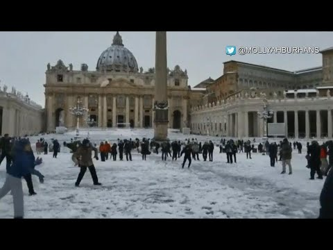 Snowball fight in St Peter's square as snow storm hits Vatican and Rome