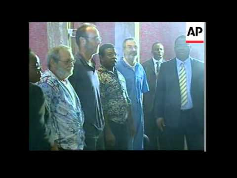 Four foreign oil workers meet president after their release by militiamen