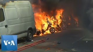 Tear Gas and Motorcycles on Fire at 'Yellow Vests' Protest in Paris
