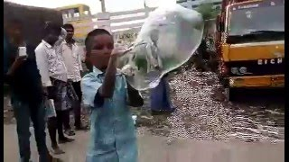 Street Boy Make Air Bubbles Without any Equipment