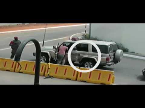 Akufo-Addo invisible forces chasing and beating a police officer at the Flagstaff House
