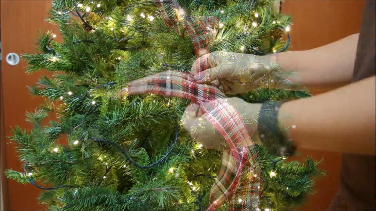 adding ribbon to a christmas tree