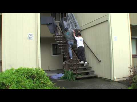 how to move an upright piano down stairs