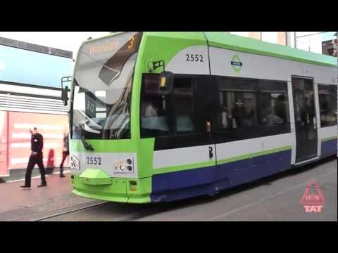 London trams in a pedestrianized zone