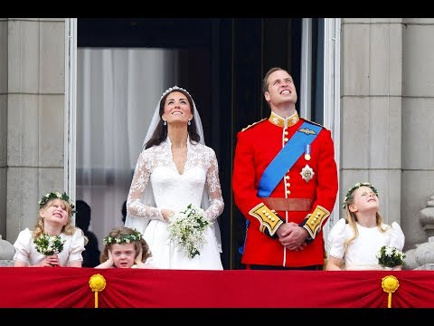 The Duke and Duchess of Cambridge watch the fly past with their families