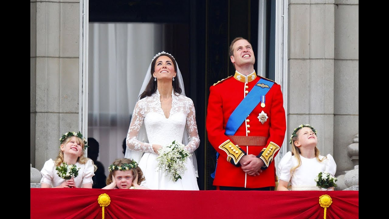 The Duke and Duchess of Cambridge watch the fly past with their ...