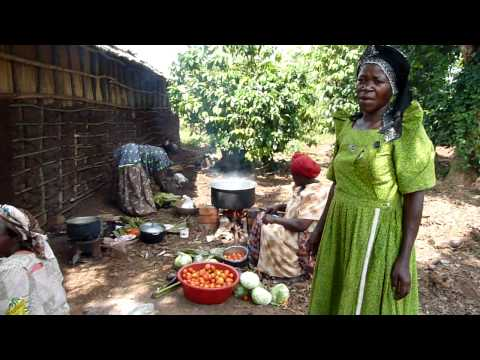 Party cooking by Ugandan women
