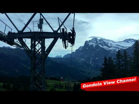 Gondola view of the Wetterhorn from the longest cable car in Europe - Männlichenbahn (HD)