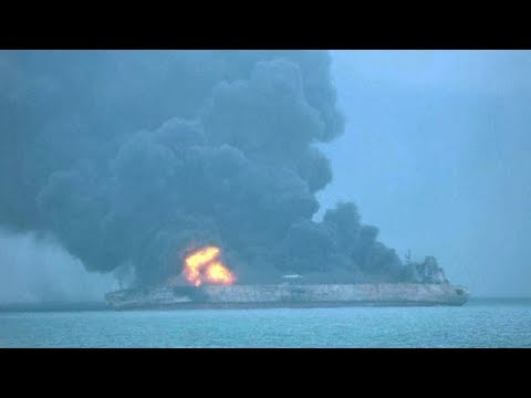 Iranian tanker ablaze and 32 crew missing after collision with freighter off China coast