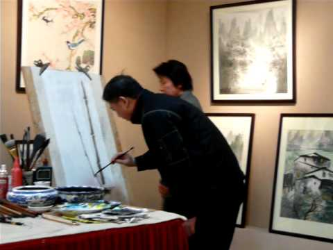 Chinese artist painting on rice paper in Guilin