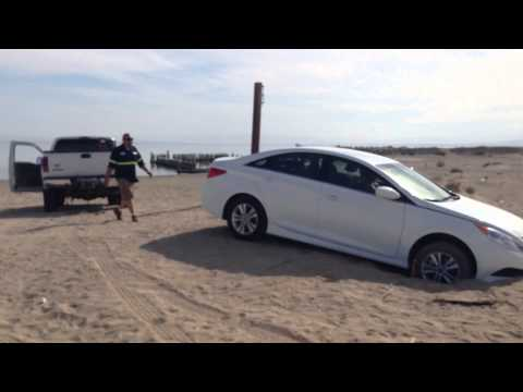 Car stuck in sand on Bombay Beach, Salton Sea