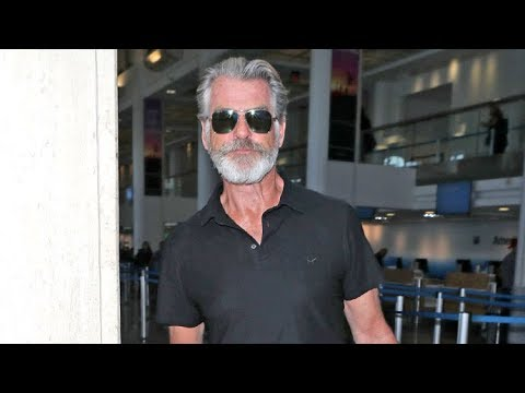 Proud Dad Pierce Brosnan Returns Home After Attending Son Paris' Milan Fashion Week Debut