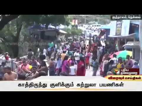 Long queues on weekend to bath in Courtallam waterfalls