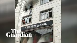 Four children thrown to safety from burning building in Istanbul