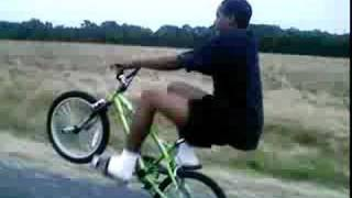 Crack head doing a Long Bike Wheelie