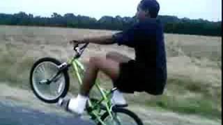 Crack head doing a Long Bike Wheelie